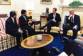 United States President Bill Clinton meets with Finance Minister TARRIN Nimmanahaeminda of Thailand in the Oval Office of the White House in Washington, DC on January 23, 1998.  Pictured from left to right: Ambassador of Thailand to the United States NITYA Pibulsonggram, Finance Minister TARRIN Nimmanahaeminda, US Vice President Al Gore, and President Clinton.<br /> Mandatory Credit:  Sharon Farmer / White House via CNP