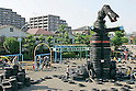 "Japanese children play at Nishi Rokugo Koen in Tokyo on September 6, 2009. The ""Tire Park"" is filled with big tires in every combination, like robots, dragons, tire swings, bridges, tunnels, montains and slides. Approximately 3,000 old tires are used to set up the playground covered completely with sand. (Photo by Laurent Benchana/Nippon News)"