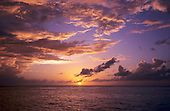 St. Lucia. View out to sea at sunset with golden clouds and sky.
