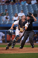 Connecticut Tigers catcher Shane Zeile (59) looks for a foul ball popup in front of umpire Donnie Smith during the first game of a doubleheader against the Brooklyn Cyclones on September 2, 2015 at Senator Thomas J. Dodd Memorial Stadium in Norwich, Connecticut.  Brooklyn defeated Connecticut 7-1.  (Mike Janes/Four Seam Images)