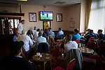Supporters watching a Premier League match on television in the social club next to the Mersey Travel Arena, home to Marine Football Club, before they played host to Ilkeston FC in a Northern Premier League premier division match. The match was won by the home side by 3 goals to 1 and was watched by a crowd of 398. Marine are baed in Crosby, Merseyside and have played at Rossett Park (now the Mersey Travel Arena)  since 1903, the club having been formed in 1894.