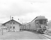 D&amp;RGW San Juan making the Cumbres station stop.  View shows east end of depot and rear of train where parlor car &quot;Durango&quot; with a Shavano drumhead is the trailing car.<br /> D&amp;RGW  Cumbres, CO  Taken by Peyton, Ernie S. - spring 1950
