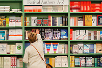 Friday  27 May 2016<br /> Pictured: A woman browses the books at the festival shop<br /> Re: The 2016 Hay festival take place at Hay on Wye, Powys, Wales