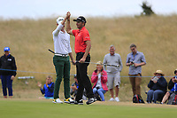Brandon Stone (RSA) eagles the 16th to go to 20 under par high fives Dean Burmester (RSA) during the final round of the Aberdeen Standard Investments Scottish Open, Gullane Golf Club, Gullane, East Lothian, Scotland. 15/07/2018.<br /> Picture Fran Caffrey / Golffile.ie<br /> <br /> All photo usage must carry mandatory copyright credit (&copy; Golffile | Fran Caffrey)