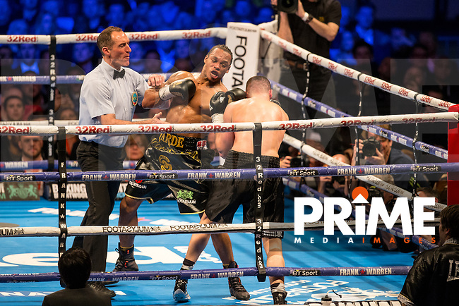 The Referee holds back Anthony Yarde to stop the fight with Yarde as the winner - THE WBO INTERCONTINENTAL LIGHT-HEAVYWEIGHT CHAMPIONSHIP 10 X 3 Minute Rounds ANTHONY YARDE 12st 5lb 8oz V NIKOLA SJEKLOCA 12st 6lbs 6oz during the Boys are back in town - Frank Warren Boxing event at the Copper Box Arena, London, England on 9 December 2017. Photo by Andy Rowland.