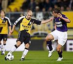Nederland, Breda, 20 april 2012.Eredivisie.Seizoen 2011-2012.NAC Breda-Roda JC.Anthony Lurling (l.) van NAC Breda schiet. Rechts Laurent Delorge van Roda JC