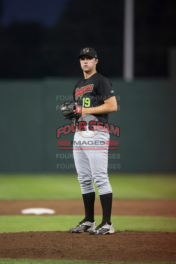 Great Falls Voyagers relief pitcher Chris Comito (19) prepares to deliver a pitch during a Pioneer League game against the Idaho Falls Chukars at Melaleuca Field on August 18, 2018 in Idaho Falls, Idaho. The Idaho Falls Chukars defeated the Great Falls Voyagers by a score of 6-5. (Zachary Lucy/Four Seam Images)