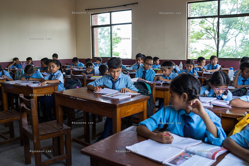 Class 5 students study in their classroom as their teachers conduct classes in SOS Children's Villages Sanothimi, Bhaktapur, Nepal on 2 July 2015. SOS Children's Villages private schools are known as very good schools in the communities where they have been established, and many of its students are paying students from the communities around the schools and are not beneficiaries of the SOS Children's Villages charity programs. Photo by Suzanne Lee for SOS Children's Villages