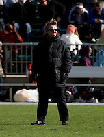 Head coach Paul Ratcliffe of Stanford watches his team before the final of the NCAA Women's College Cup at WakeMed Soccer Park in Cary, NC.  Notre Dame defeated Stanford, 1-0.
