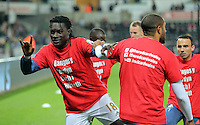"(L-R) Bafetimbi Gomis and Ashley Williams of Swansea warm up wearing a ""Show Racism A Red Card"" before the Barclays Premier League match between Swansea City and Stoke City played at the Liberty Stadium, Swansea on October 19th 2015"