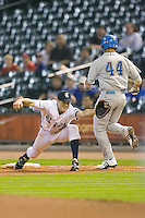 Jimmy Comerota #2 of the Rice Owls is pulled off the bag as he stretches for a throw versus the UCLA Bruins in the 2009 Houston College Classic at Minute Maid Park February 27, 2009 in Houston, TX.  The Owls defeated the Bruins 5-4 in 10 innings. (Photo by Brian Westerholt / Four Seam Images)