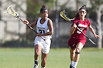 Los Angeles, CA 02/08/13 - Melissa Carelli  (Umass #3) and Jess Carroll  (Northwestern #21) in action during the Northwestern vs UMass NCAA Women's Lacrosse game at USC's McAlister Field.