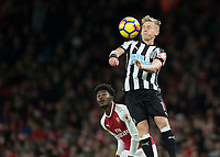 Matt Ritchie of Newcastle United gets to the ball before Ainsley Maitland-Niles of Arsenal during the Premier League match between Arsenal and Newcastle United at the Emirates Stadium, London, England on 16 December 2017. Photo by Vince  Mignott / PRiME Media Images.