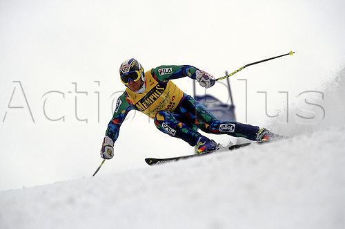 March 1995: Italian skier Alberto Tomba (ITA) competes in the slalom at the Skiing World Cup finals in Bormio, Italy. Photo: Glyn Kirk/actionplus..9503 man men male ski snow sport winter racing racer race