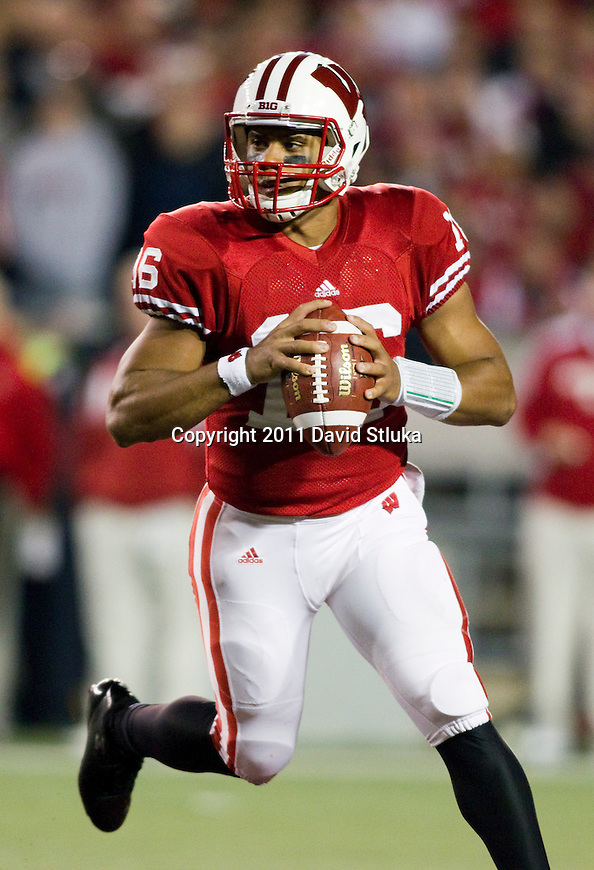 Wisconsin Badgers quarterback Russell Wilson (16) looks for a receiver during an NCAA Big Ten Conference college football game against the Nebraska Cornhuskers on October 1, 2011 in Madison, Wisconsin. The Badgers won 48-17. (Photo by David Stluka)