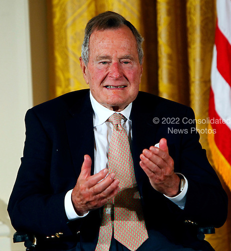 Former United States President George H.W. Bush and U.S. President Barack Obama (not pictured) at a ceremony in the East Room of the White House to present the 5,000th &quot;Daily Point of Life&quot; on July 15, 2013.  <br /> Credit: Dennis Brack / Pool via CNP