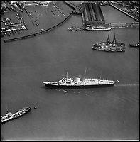 BNPS.co.uk (01202 558833)<br /> Pic: Aerofilms/HistoricEngland/BNPS<br /> <br /> Portsmouth - HMS Britannia, 8 May 1959.<br /> <br /> Stunning historic aerial photos of seaside towns, naval bases, ports and shipyards which tell the story of Britain's once-great maritime tradition feature in a new book.<br /> <br /> The fascinating archive of black and white images includes views from a bygone age such as Brighton's famous West Pier, Grimsby's burgeoning fishing fleet, and London's dock yards.<br /> <br /> Iconic ships were also captured from the skies including the Cutty Sark in its final seaworthy years on the Thames, HMY Britannia in 1959, the RMS Queen Mary in 1946 and the SS Queen Elizabeth in 1969 about to make her maiden voyage.<br /> <br /> England's Maritime Heritage from the Air, by Peter Waller, is published by English Heritage and costs &pound;35.