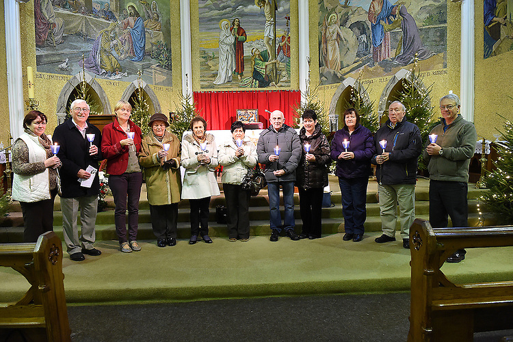 Rita Hanratty, Joey Maher, Geraldine McCabe, Rita Cummins, Doris Maher, Christine Mallon, Joe Mallon, Jean Carbery, Monica Mooney, Patrick Mooney and Eugene Carbery who took part in the candlelit event to mark the year of hope for 2015 to save the church.  Photo:Colin Bell/pressphotos.ie
