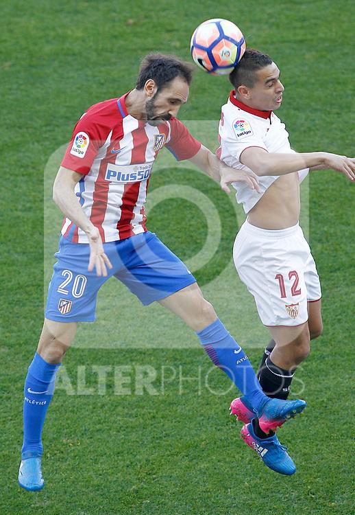 Atletico de Madrid's Juanfran Torres (l) and Sevilla FC's Wissam Ben Yedder during La Liga match. March 19,2017. (ALTERPHOTOS/Acero)