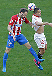 Atletico de Madrid's Juanfran Torres (l) and Sevilla FC's Wissam Ben Yedder during La Liga match. March 19,2017. (ALTERPHOTOS/Acero)