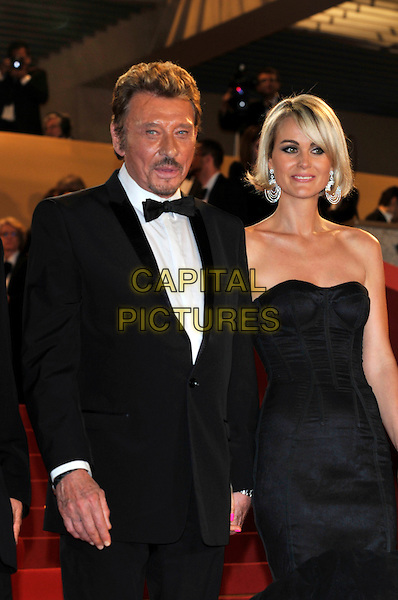 JOHNNY HALLYDAY, LAETITIA HALLYDAY.'Vengance' screening.62nd International Cannes Film Festival.Cannes, France. 17th May 2009.half length married husband wife  strapless black dress bustier tux bow tie tuxedo .CAP/PL.©Phil Loftus/Capital Pictures