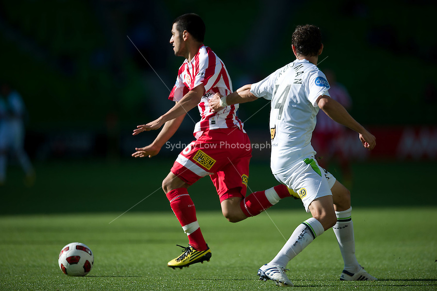 MELBOURNE, AUSTRALIA - January 2:  Aziz Behich of the Heart and Chris Grossman of the Fury contest the ball during the round 21 A-League match between Melbourne Heart and North Queensland Fury at AAMI Park on January 2, 2011 in Melbourne, Australia. (Photo by Sydney Low / Asterisk Images)