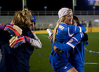 Abby Dahlkemper (8) of UCLA celebrates with a teammate Kodi Lavrusky (10) after the NCAA Women's College Cup finals at WakeMed Soccer Park in Cary, NC.  UCLA defeated Florida State, 1-0, in overtime.