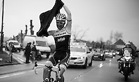 Fumi Beppu (JAP/Trek-Segafredo) struggling with the rain jacket<br /> <br /> 71st Dwars door Vlaanderen (1.HC)