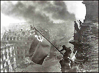 BNPS.co.uk (01202 558833)<br /> Pic: Bonhams/BNPS<br /> <br /> ***Use Full Byline***<br /> <br /> Yevgeny Khaldiei iconic image, 'Raising the flag over the Reichstag'.<br /> <br /> <br /> A camera which took one of the most iconic photographs of the Second World War has emerged for sale for 340,000 pounds.<br /> <br /> The Leica camera belonged to Soviet photographer Yevgeni Khaldei who was with the Red Army when they captured Berlin in May 1945, bringing about an end to WWII.<br /> <br /> Khaldei scaled the Reichstag on May 2 to capture on camera a soldier raising the Red Banner, the Soviet flag, to claim the symbolic building as under their control.<br /> <br /> In fact it was a restaging of a moment which had happened two days previously but resilient Nazi fighters had taken the original flag down overnight.<br /> <br /> The final image was heavily edited to add more smoke to the scene and also cover up the watches on the wrists of the soldiers which had been looted.<br /> <br /> It went on to become one of the most famous images of the war and was reproduced in publications around the world.<br /> <br /> It is often compared to the photograph of US troops raising the Stars and Stripes on the Japanese island of Iwo Jima.<br /> <br /> The camera is now tipped to fetch 340,000 pounds when it goes under the hammer at Bonhams.