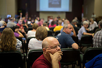 NWA Democrat-Gazette/CHARLIE KAIJO Randy Hamm of Bella Vista listens to speakers share their opinions about the Confederate statue in Bentonville Square at the Walmart Auditorium in the Shewmaker Center for Workforce Technologies, NWACC Campus in Bentonville, AR on Saturday, September 9, 2017. Community members discussed opinions on the Confederate soldier statue in the Bentonville Square and what should be done about it.
