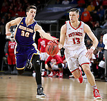 SIOUX FALLS, SD: MARCH 4: Matt Mooney #13 from the University of South Dakota pushes then all as Mike Miklusak #30 from Western Illinois tries to knock it away on March 4, 2017 during the Summit League Basketball Championship at the Denny Sanford Premier Center in Sioux Falls, SD. (Photo by Dave Eggen/Inertia)