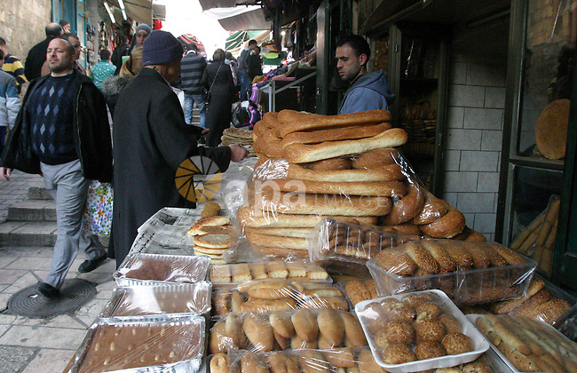 A Palestinian man sells bread in the main market in Jerusalem's old city, on Feb. 12, 2013. Photo by Mahfouz Abu Turk
