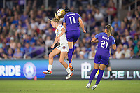 Orlando, FL - Saturday March 24, 2018: Utah Royals forward Brittany Ratcliffe (25) and Orlando Pride defender Ali Krieger (11) challenge for a header during a regular season National Women's Soccer League (NWSL) match between the Orlando Pride and the Utah Royals FC at Orlando City Stadium. The game ended in a 1-1 draw.