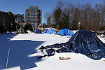 24 January 2016: Most of the tents survived a storm that dropped 3 inches of sleet on Durham. Krzyzewskiville, a Duke student campground next to Cameron Indoor Stadium (behind, left) in Durham, North Carolina.