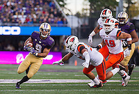 Myles Gaskin finds a huge hole.  Gaskin rushed for 128 yards and a touchdown.