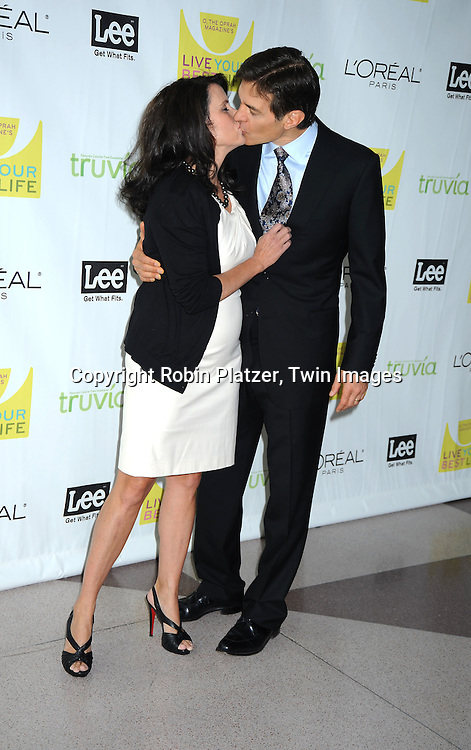 """Lisa and Dr Mehmet Oz kissing at O, The Oprah Magazine's  Celebration of  it's 10th Anniversay at the """"Live Your Best Life"""" event at The Jacob Javits Center on May 8, 2010."""