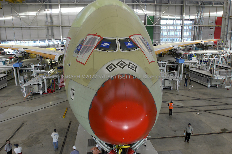 6/7/2004--Toulouse, France..The first A380 super Jumbo is prepared for final assembly at Airbus's hanger. European aircraft maker Airbus launched production of its A380 ?superjumbo,? the biggest ever commercial airliner, stepping up its challenge to U.S. rival Boeing Co. which has staked its future on a new mid-sized jet...Photograph by Stuart Isett.©2004 Stuart Isett. All rights reserved