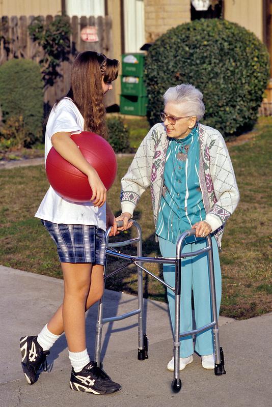 Young girl talking with an elderly woman. Sacramento, California.