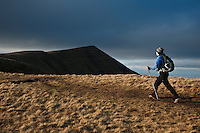 Female hiker hiking towards summit of Cribyn, Brecon Beacons national park, Wales