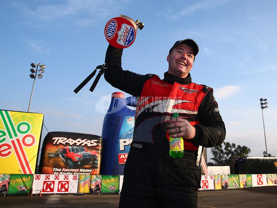 Feb 9, 2014; Pomona, CA, USA; NHRA top alcohol funny car driver Brian Hough celebrates after winning the Winternationals at Auto Club Raceway at Pomona. Mandatory Credit: Mark J. Rebilas-