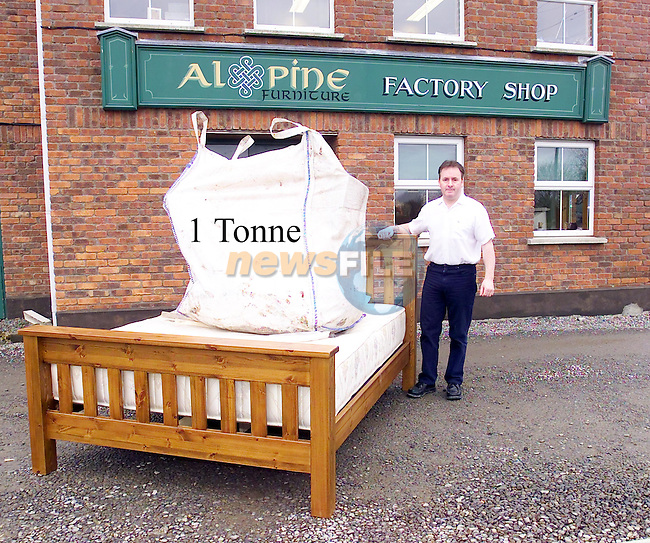 Ken Healy from Alpine Furniture with the strongest bed in Ireland..Picture Fran Caffrey Newsfile...This Picture is sent to you by:..Newsfile Ltd.The View, Millmount Abbey, Drogheda, Co Louth, Ireland..Tel: +353419871240.Fax: +353419871260.GSM: +353862500958.ISDN: +353419871010.email: pictures@newsfile.ie.www.newsfile.ie