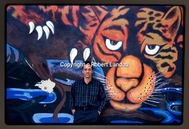 Ray Manzarek in front of Venice mural while filming LA Woman 1n 1984