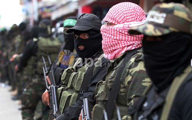 Hamas militants take part in the funeral of Hamas female lawmaker Mariam Farahat in Gaza City March 17, 2013. Farahat, who became an icon to Palestinian women in Gaza for losing three of her sons in the Palestinian-Israeli conflict, died on Sunday after a long struggle with disease, according to local media. Photo by Ashraf Amra