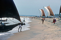 A fisherman drags his boat ashore in Negombo, Sri Lanka in 1996.