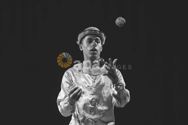 Clown with little balls in Black and White. Photo by Sanad Ltefa