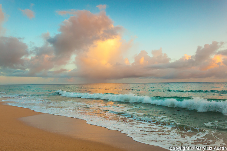 Kauai, HI:  Clearing storm clouds and turquoise waters at sunrise on Kauapea Beach, known locally as Secret Beach