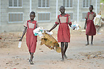 Students pick up trash during a clean up in the Loreto Primary School in Rumbek, South Sudan. The Loreto Sisters began a secondary school for girls in 2008, with students from throughout the country, but soon after added a primary in response to local community demands.