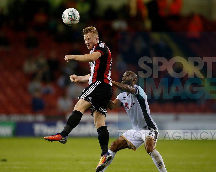 Mark Duffy of Sheffield Utd out jumps Adam Chambers of Walsall during the Carabao Cup First Round match at Bramall Lane Stadium, Sheffield. Picture date: August 9th 2017. Pic credit should read: Simon Bellis/Sportimage
