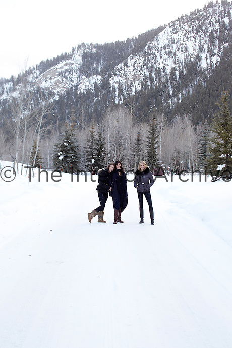Mary Lynn Turner with daughters Marie Turner Carson and Emily Turner enjoy the snow-covered landscape around their home