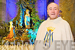 Fr Kevin McNamara, pictured at the Lourdes Grotto in the specially erected Sacred Space of St Marys Cathedral, Killarney where huge numbers have gathered for the Our Lady of Lourdes novena.